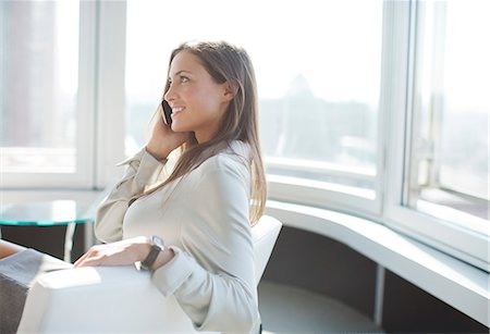 Businesswoman talking on phone in office Stock Photo - Premium Royalty-Free, Code: 6113-06625770