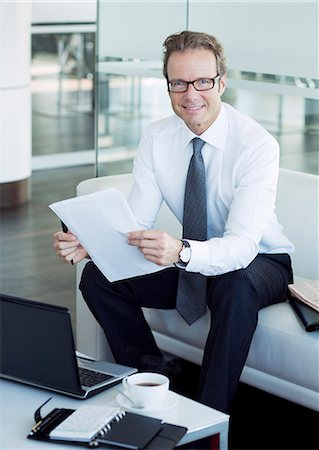 planner - Businessman working in office lobby Stock Photo - Premium Royalty-Free, Code: 6113-06625730