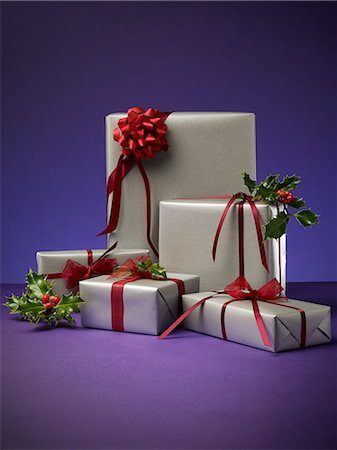 present wrapped close up - Stack of wrapped Christmas presents Stock Photo - Premium Royalty-Free, Code: 6113-06626090