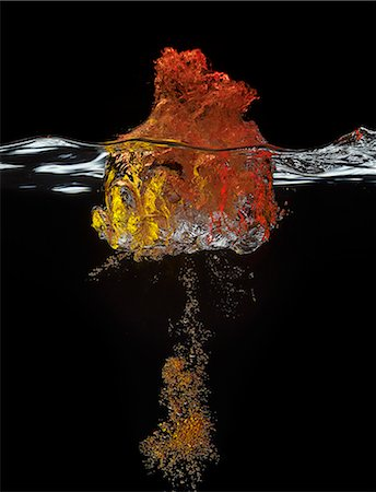 exploding - High speed image of bubbles underwater Stock Photo - Premium Royalty-Free, Code: 6113-06626095