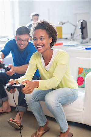 Couple playing video games together Stock Photo - Premium Royalty-Free, Code: 6113-06626006