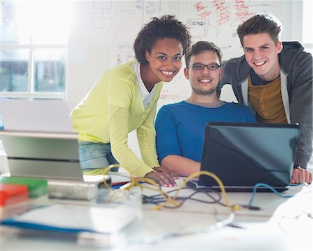 displaying - Business people working together at desk Stock Photo - Premium Royalty-Free, Code: 6113-06626022