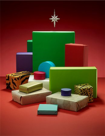 Stack of wrapped Christmas presents Stock Photo - Premium Royalty-Free, Code: 6113-06626107