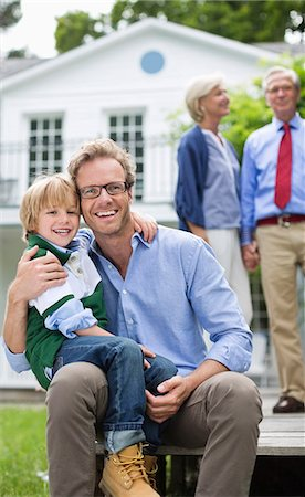 five - Father and son smiling outside house Stock Photo - Premium Royalty-Free, Code: 6113-06626369