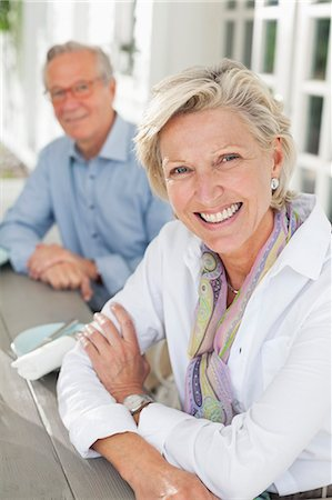 senior adult - Couple smiling together at table Stock Photo - Premium Royalty-Free, Code: 6113-06626376