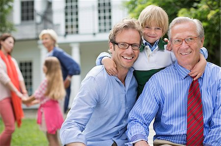 Three generations of men smiling together Stock Photo - Premium Royalty-Free, Code: 6113-06626324