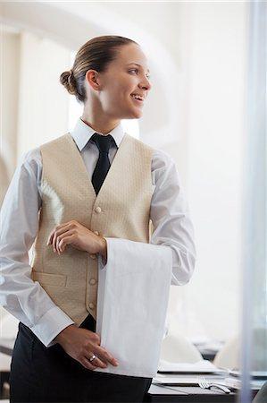 Waitress smiling in restaurant Stock Photo - Premium Royalty-Free, Code: 6113-06626543
