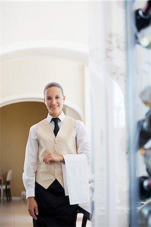 Waitress smiling in restaurant Stock Photo - Premium Royalty-Free, Code: 6113-06626547