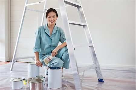 painter - Smiling woman painting room Stock Photo - Premium Royalty-Free, Code: 6113-06753257