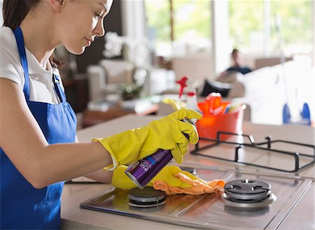 Maid cleaning stove top Stock Photo - Premium Royalty-Free, Code: 6113-06753264