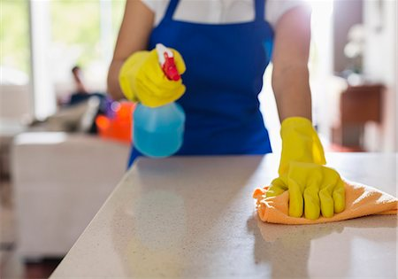 Woman cleaning kitchen counter Stock Photo - Premium Royalty-Free, Code: 6113-06753272