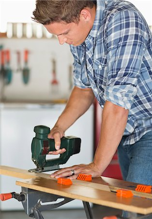 Man working in workshop Stock Photo - Premium Royalty-Free, Code: 6113-06753275