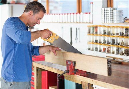 Man working in workshop Stock Photo - Premium Royalty-Free, Code: 6113-06753279