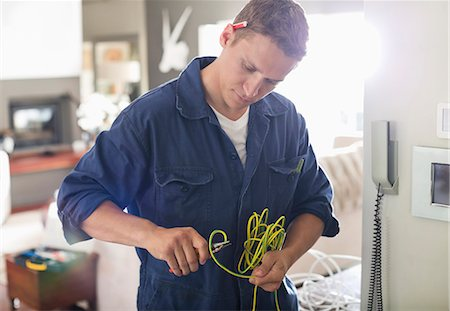 Electrician cutting wires in home Stock Photo - Premium Royalty-Free, Code: 6113-06753289