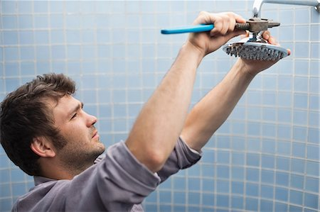 shower - Plumber working on shower head in bathroom Stock Photo - Premium Royalty-Free, Code: 6113-06753298