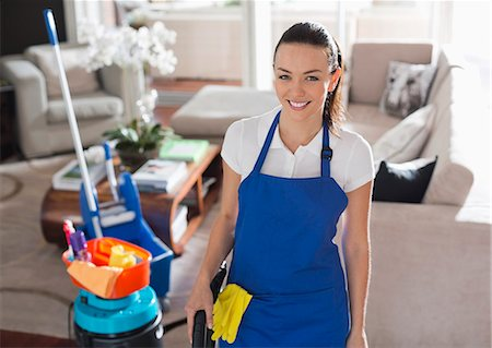 Maid smiling in living room Stock Photo - Premium Royalty-Free, Code: 6113-06753203