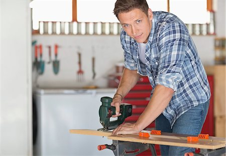 Man working in workshop Stock Photo - Premium Royalty-Free, Code: 6113-06753202