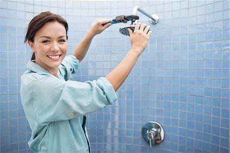 shower - Female plumber working on shower head in bathroom Stock Photo - Premium Royalty-Free, Code: 6113-06753214