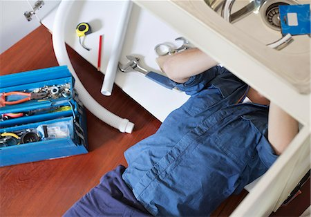 diy or home improvement - Plumber working on pipes under sink Stock Photo - Premium Royalty-Free, Code: 6113-06753238