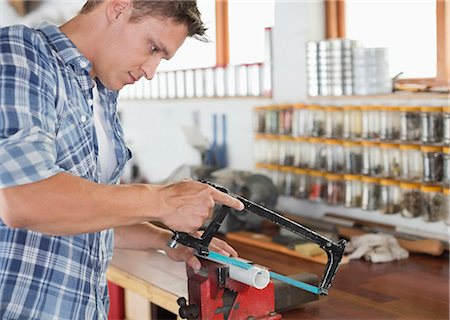 Man working in workshop Stock Photo - Premium Royalty-Free, Code: 6113-06753350