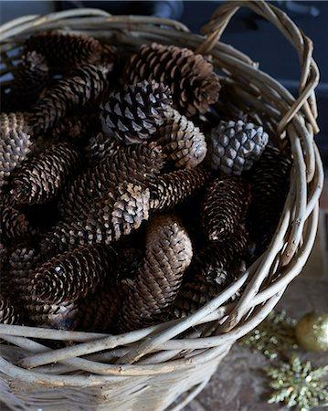 Close up of basket of pine cones Stock Photo - Premium Royalty-Free, Code: 6113-06753389