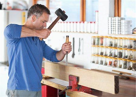 Man working in workshop Stock Photo - Premium Royalty-Free, Code: 6113-06753305