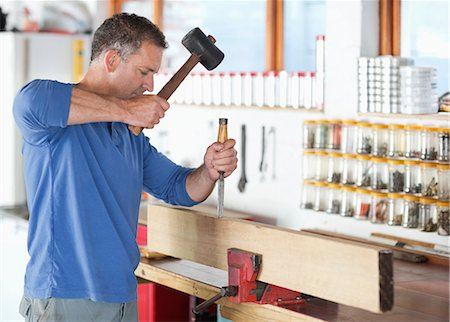 Man working in workshop Stock Photo - Premium Royalty-Free, Code: 6113-06753305