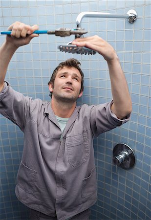 shower - Plumber working on shower head in bathroom Stock Photo - Premium Royalty-Free, Code: 6113-06753330