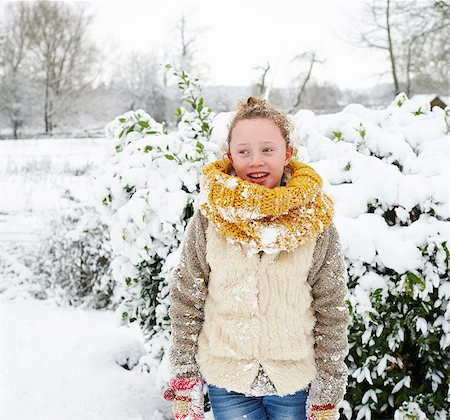 Girl smiling in snow Stock Photo - Premium Royalty-Free, Code: 6113-06753401