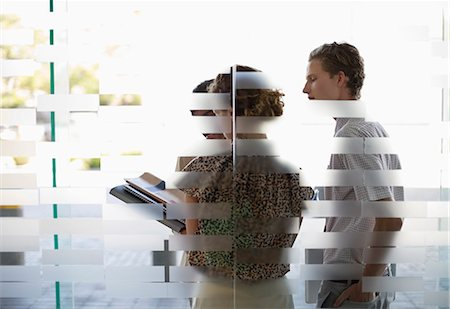 Business people talking in office Stock Photo - Premium Royalty-Free, Code: 6113-06753425