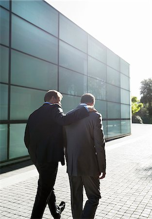 Businessmen talking on city street Stock Photo - Premium Royalty-Free, Code: 6113-06753433