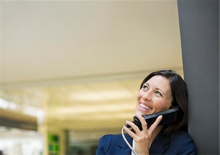 Businesswoman talking on phone Stock Photo - Premium Royalty-Free, Code: 6113-06753434