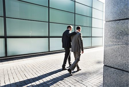 shadow - Businessmen talking on city street Stock Photo - Premium Royalty-Free, Code: 6113-06753511