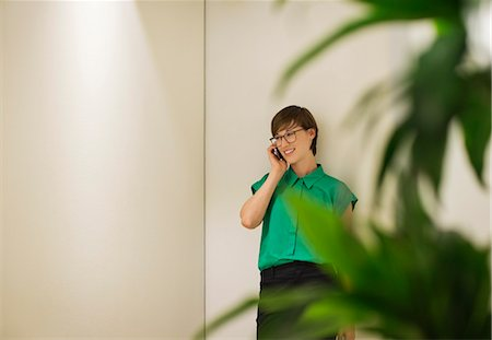 Businesswoman talking on cell phone Stock Photo - Premium Royalty-Free, Code: 6113-06753516