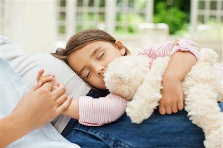 Girl napping on pregnant mother's lap Stock Photo - Premium Royalty-Free, Code: 6113-06753635