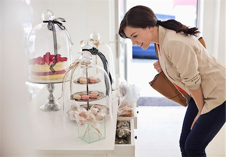 Woman admiring cookies in store Stock Photo - Premium Royalty-Free, Code: 6113-06753715