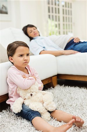 Angry girl watching television with mother Stock Photo - Premium Royalty-Free, Code: 6113-06753728
