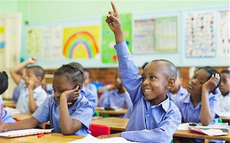 Student raising hand in class Stock Photo - Premium Royalty-Free, Code: 6113-06753873