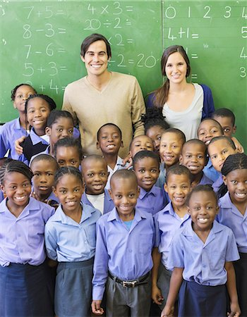 Students and teachers smiling in class Stock Photo - Premium Royalty-Free, Code: 6113-06753877