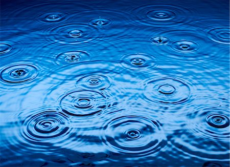 droplet - Ripples of raindrops in puddle Stock Photo - Premium Royalty-Free, Code: 6113-06753878