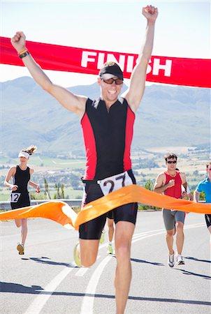 finish line - Runner crossing race finish line Stock Photo - Premium Royalty-Free, Code: 6113-06753968