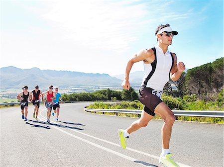 runner (male) - Runners in race on rural road Stock Photo - Premium Royalty-Free, Code: 6113-06753983