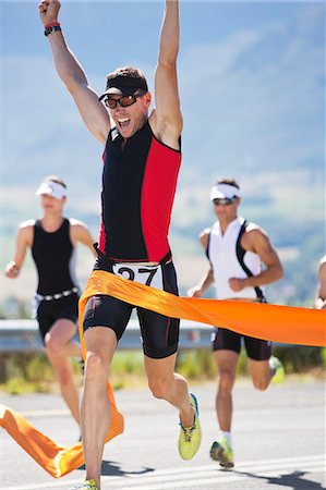 finish line - Runner crossing race finish line Stock Photo - Premium Royalty-Free, Code: 6113-06754060
