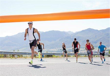 finish line - Runners crossing race finish line Stock Photo - Premium Royalty-Free, Code: 6113-06754084