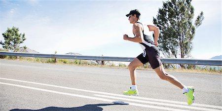 runner (male) - Runner in race on rural road Stock Photo - Premium Royalty-Free, Code: 6113-06754021