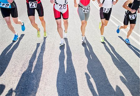 shadow - Runners in race on rural road Stock Photo - Premium Royalty-Free, Code: 6113-06754024