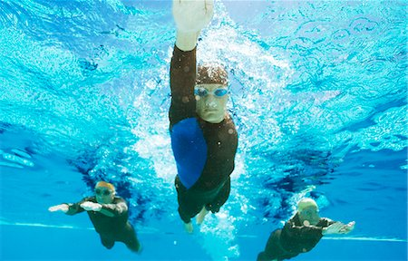 swimming - Triathletes in wetsuits underwater Stock Photo - Premium Royalty-Free, Code: 6113-06754028