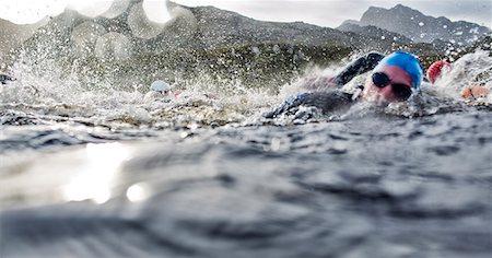 swimming - Swimmers splashing in water Stock Photo - Premium Royalty-Free, Code: 6113-06754140