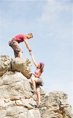 partnership - Climbers scaling steep rock face Stock Photo - Premium Royalty-Free, Code: 6113-06754177