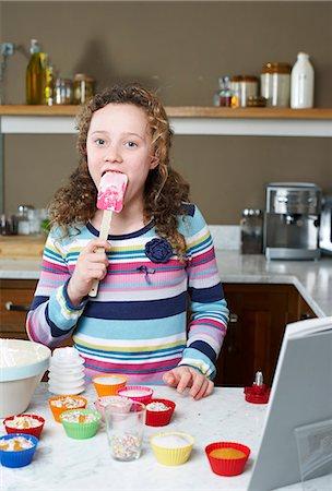 preteen girl licking - Girl licking spatula and baking Stock Photo - Premium Royalty-Free, Code: 6113-06754191